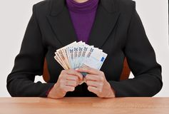 Businesswoman holding Euro notes Stock Photo