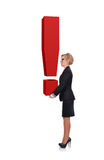 Businesswoman holding exclamation mark Stock Images