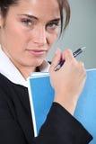 Businesswoman holding file Stock Photos