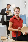 Businesswoman holding file folder Royalty Free Stock Image
