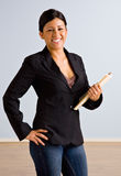 Businesswoman holding file folders Stock Photography