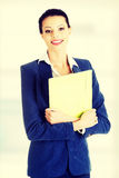 Businesswoman holding files. Royalty Free Stock Photo