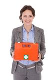 Businesswoman Holding First Aid Box. Smiling Young Businesswoman Holding First Aid Box Over White Background Stock Photography