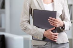 Businesswoman holding folder Royalty Free Stock Image