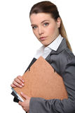 Businesswoman holding folder Stock Photos
