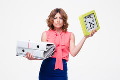 Businesswoman holding folder and clock Royalty Free Stock Images