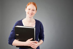 Businesswoman Holding a Folder with Documents Royalty Free Stock Photography