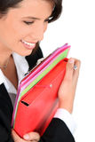 Businesswoman holding folders Stock Photos