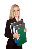 Businesswoman holding folders. A businesswoman holding folders on a white background Royalty Free Stock Image