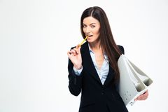 Businesswoman holding folders and biting pencil Royalty Free Stock Photo