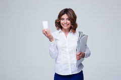 Businesswoman holding folders and cup with coffee Stock Image
