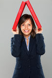 Businesswoman holding folders Stock Images
