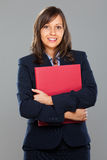 Businesswoman holding folders Stock Photography