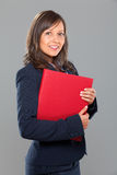 Businesswoman holding folders Royalty Free Stock Image