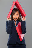 Businesswoman holding folders Stock Image