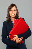 Businesswoman holding folders Royalty Free Stock Photography