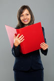 Businesswoman holding folders Royalty Free Stock Photo