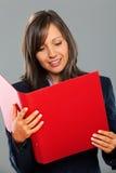 Businesswoman holding folders Stock Photography