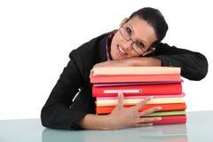 Businesswoman holding folders Stock Photo