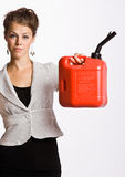 Businesswoman holding gas can. Businesswoman holding up gas can royalty free stock image