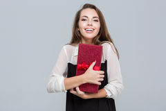 Businesswoman holding gift box Royalty Free Stock Image