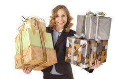 Businesswoman holding giftboxes Stock Photo