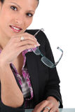 Businesswoman holding glasses Royalty Free Stock Images