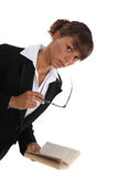 Businesswoman holding glasses Stock Photography