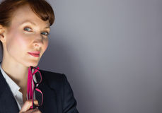 Businesswoman holding glasses and thinking Royalty Free Stock Image