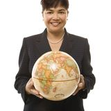 Businesswoman holding globe. Royalty Free Stock Photography