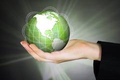Businesswoman Holding Globe With Binary Code Stock Photo