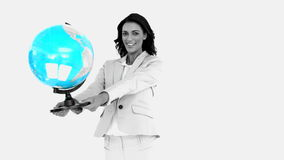 Businesswoman holding globe stock footage