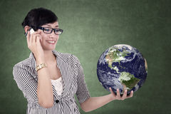 Businesswoman holding a globe Stock Photo