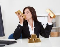 Businesswoman Holding Gold Bar Royalty Free Stock Photography