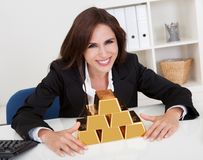 Businesswoman Holding Gold Bar Stock Image