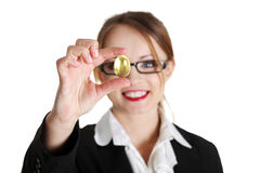 Businesswoman holding gold egg Stock Images