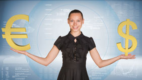 Businesswoman holding golden dollar and euro Royalty Free Stock Image