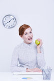Businesswoman holding green apple Royalty Free Stock Photos