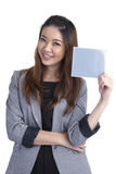 Businesswoman holding grey blank sign Stock Photography
