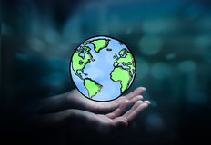 Businesswoman holding hand drawn planet earth Stock Photo