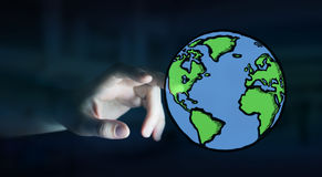 Businesswoman holding hand drawn planet earth Stock Image