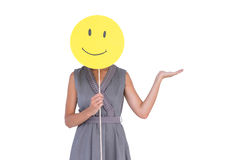 Businesswoman holding happy smiley face. On white background stock images