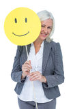 Businesswoman holding happy smiley face Royalty Free Stock Image