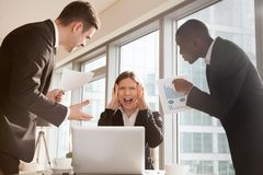 Woman stressed because of mistake in work papers Royalty Free Stock Photography
