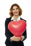 Businesswoman holding a heart shaped balloon Stock Photography