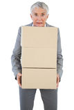 Businesswoman holding heavy cardboard boxes Royalty Free Stock Image