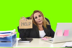 Businesswoman holding help sign working desparate in stress  green chroma key. Frustrated business woman in her 40s holding help sign desperate and suffering Stock Images