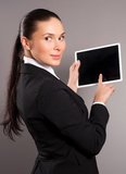 Businesswoman holding her digital tablet pc Stock Image