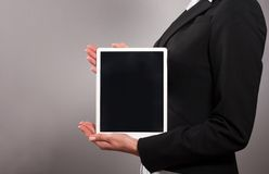 Businesswoman holding her digital tablet pc Stock Photo