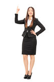 Businesswoman holding her finger up Stock Photos